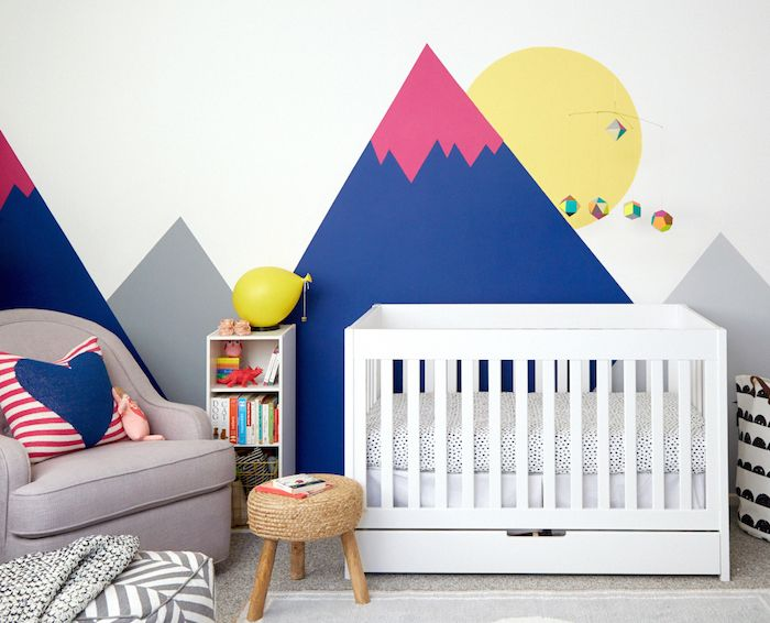 Loving the vibrant colors and whimsical wall prints in this thoughtfully chic nursery (with the perfect addition of our Savoy Glider!).