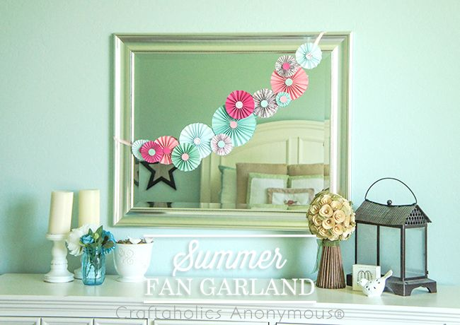 Summer Paper Fan Garland By: Erin  I wanted to add a little color to my bedroom this summer, so I made this Summer Fan Garland. I adore it...these paper fans are one of my very favorite crafts. They're so pretty and versatile. I first use