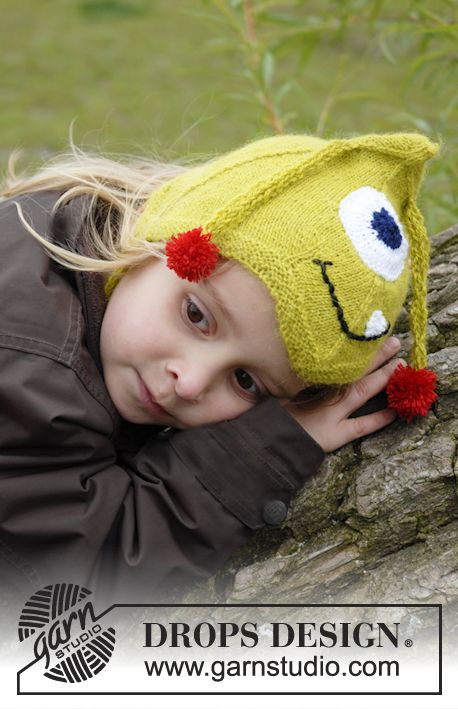 """Knitted DROPS monster hat with antennas, eyes and mouth in """"Alpaca""""."""
