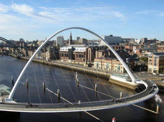 Gateshead Millennium Bridge. Pedestrian and cyclist tilt bridge spanning the River Tyne (England). Gateshead on the south bank, and Newcastle upon Tyne on the north bank.