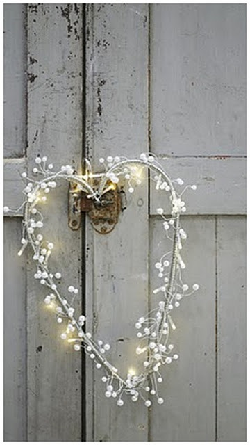 Is this cute or what. . . .Why can't I think of lights on a summer heart wreath?  Perhaps, I'm missing that cute, country door. . . .