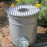 "Rocket Stove: 5 gal metal paint bucket with 4""pipe-insulated with clay soil and vermiculite mixture..."