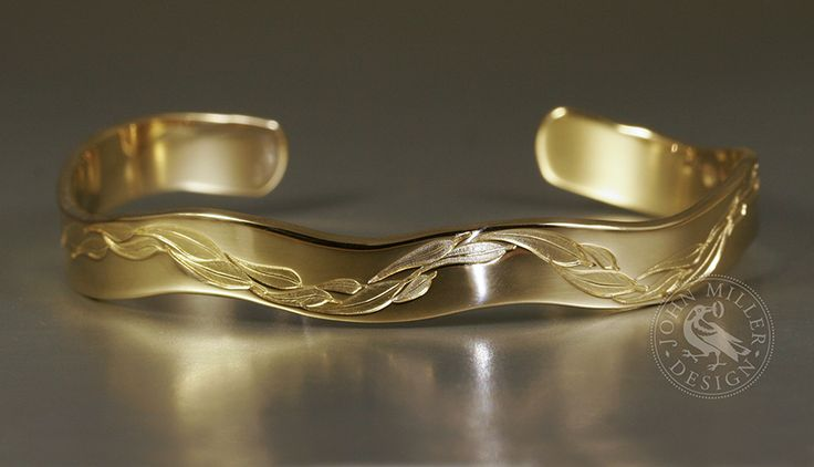 18ct yellow gold cuff, featuring a gum leaf design and a 6 curve wave