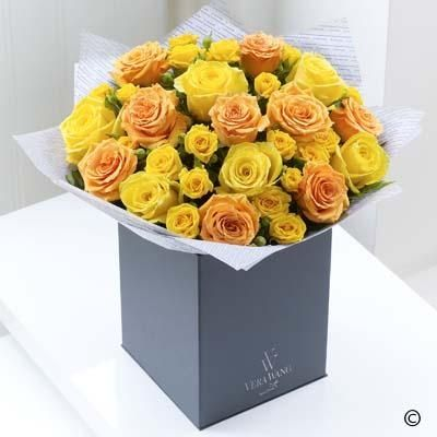 This striking Vera Wang bouquet celebrates the classic beauty of roses in grand style.  Bursting with warmth and radiant colour, these exceptional roses are resplendent in gold, pale orange and buttercup yellow tones.