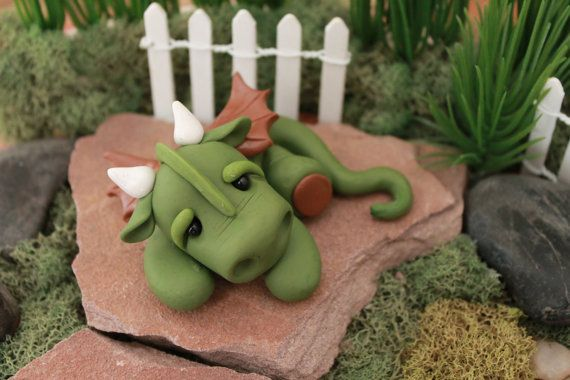 I love dragons! This little guy is a labor of love and has been completely hand sculpted from polymer clay without the use of any molds. This