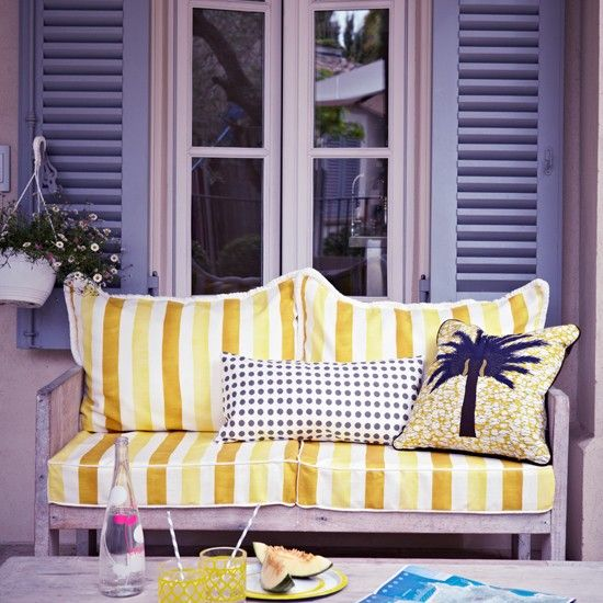 Zesty lemon garden area wtih striped yellow chair | Sunshine yellow colour schemes - 10 of the best | yellow | colour | housetohome.co.uk
