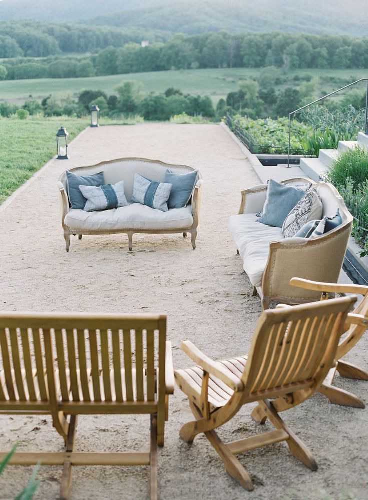 Outdoor wedding cocktail hour couch seating at Pippin Hill Farm & Vineyards | Photographer: Laura Gordon |PLANNING: The Social Office (DORI) | LIGHTING: BRAVL | RENTALS: MS Events | RENTALS: Beehive | FLORIST: Hedge Fine Blooms