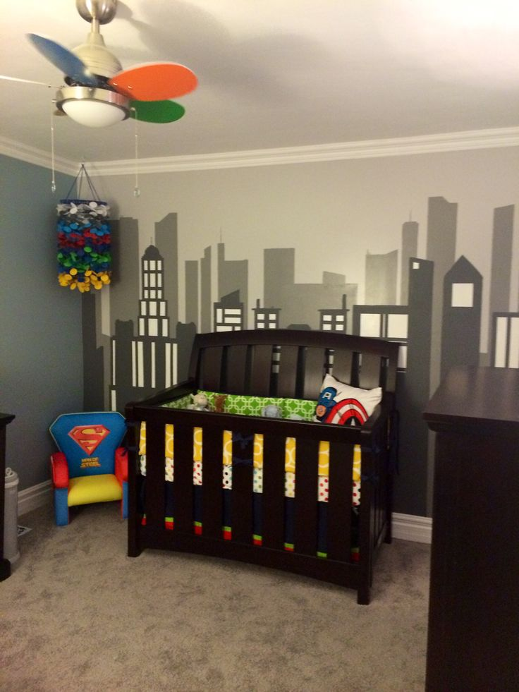 Superhero nursery with city scape mural. If I ever have a baby boy, this would be his room