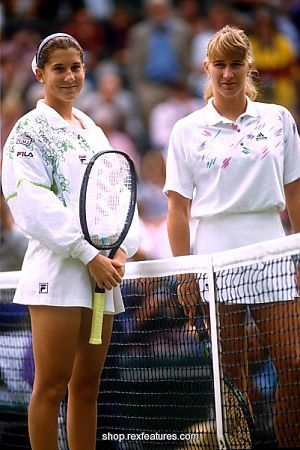 Monica Seles (left) and Steffi Graf pose for photographers prior to their Ladies Championship Final at the 1992 French Open. Heading into this match, Steffi and Monica had a combined 15 Grand Slam singles titles between them. Steffi had already racked up 10 major titles, while Monica was a 5 time Grand Slam winner.