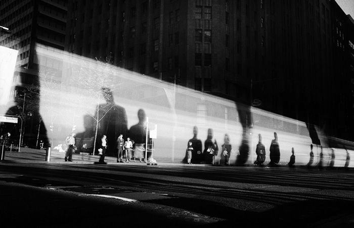 Photo by Trent Parke. I really like the long frame of all the people waiting with there shadows huge behind, again the black and white gives it depth in contrast and all standing in a row on the street is great. I really like the lighting.