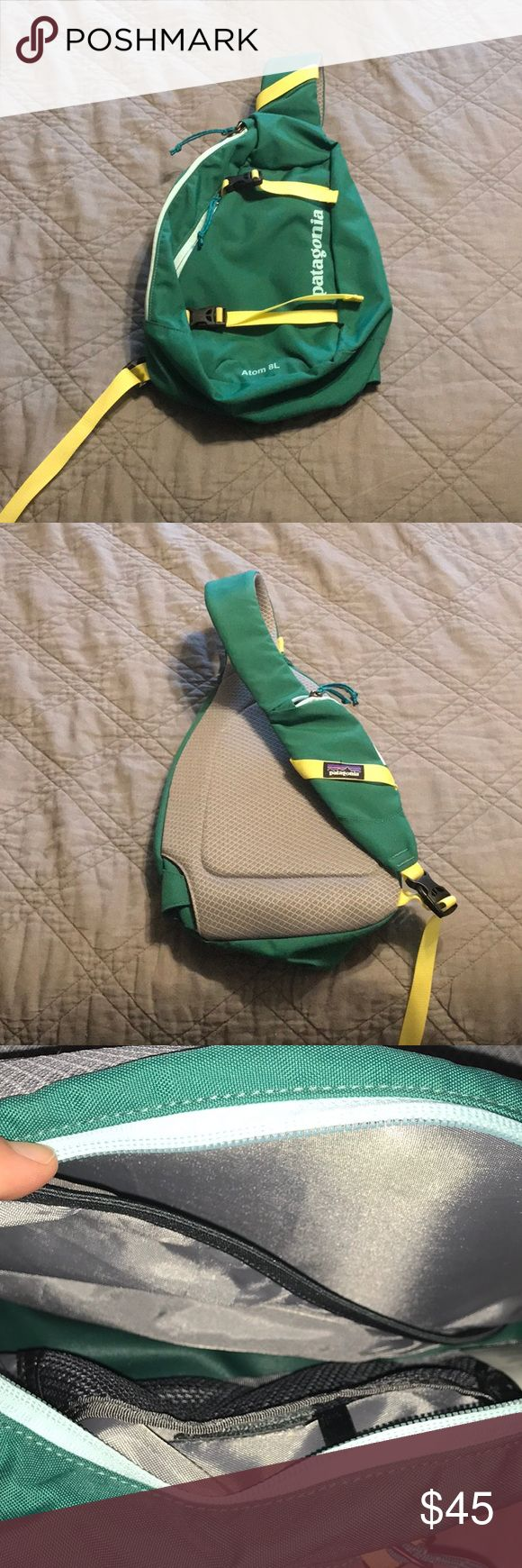 Patagonia Atom Sling Like new Patagonia Atom Sling 8L Green, light blue and yellow.  Great condition! Patagonia Bags