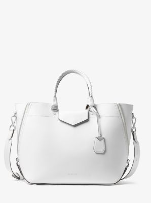 528577ddf4 Detailed with woven top handles and side zip details, our Blakely tote  offers a fresh