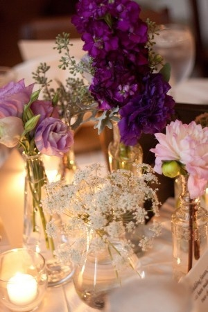 maybe for the tables without large centerpieces - a couple little vases w/ similar flowers and candles..