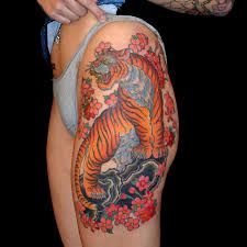 Best 25 japanese tiger tattoo ideas on pinterest for How to blend tattoos into a sleeve