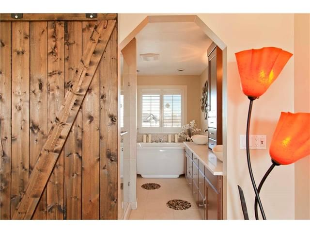 Stunning walkout home backing onto St Joan of Arc School #yycre