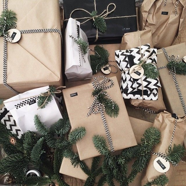 christmas gift wrapping using brown kraft paper, bakers twine, washi tape, dymo labels with wooden tags and pine tree/spruce leaves - a living diary