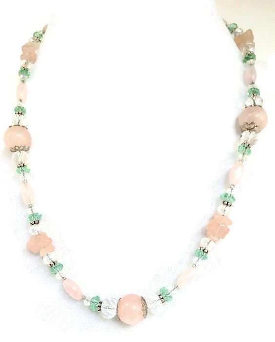 Rose Quartz, known in some places as either Bohemian Ruby or as a love stone, gives this lovely necklace its pink color and femininity. The