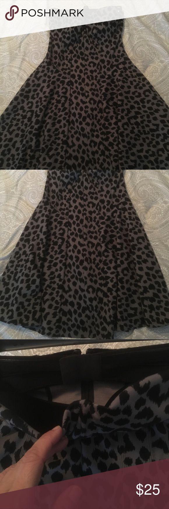 Like new! Strapless VS animal print dress Strapless grey and black animal print mini dress, built in bra, size 34A, cotton, full skirt. Comfortable and cute! Victoria's Secret Dresses Mini