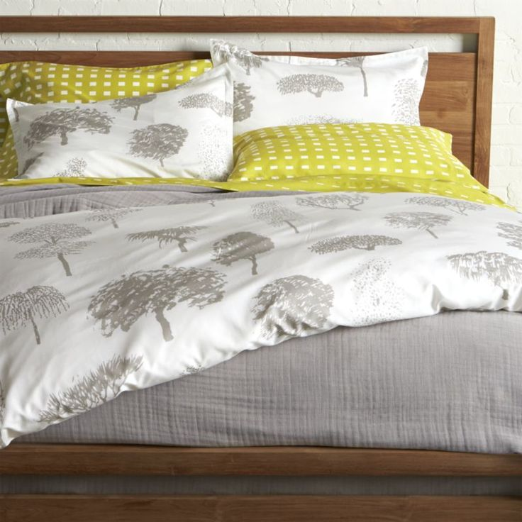 """Global forest plants grey silhouettes of the world's trees on crisp white cotton percale bedding, artfully rendered in designer Fujiwo Ishimoto's painted design.  Inspired by his observations of nature in many settings, the pattern is named Rantapuisto, a Finnish word meaning """"beach park. """" Reversible duvet cover has hidden button closure and interior fabric ties to keep the duvet in place.  Shams have a 1"""" flange and generous overlapping back closure.  Duvet inserts and bed pillows ..."""
