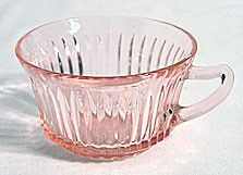 These are pink Depression Glass cups in the Queen Mary pattern made by Hocking. They measure 2 and 1 eighth inches high and 3.5 inches wide at the top plus the handle. They are in nice condition with