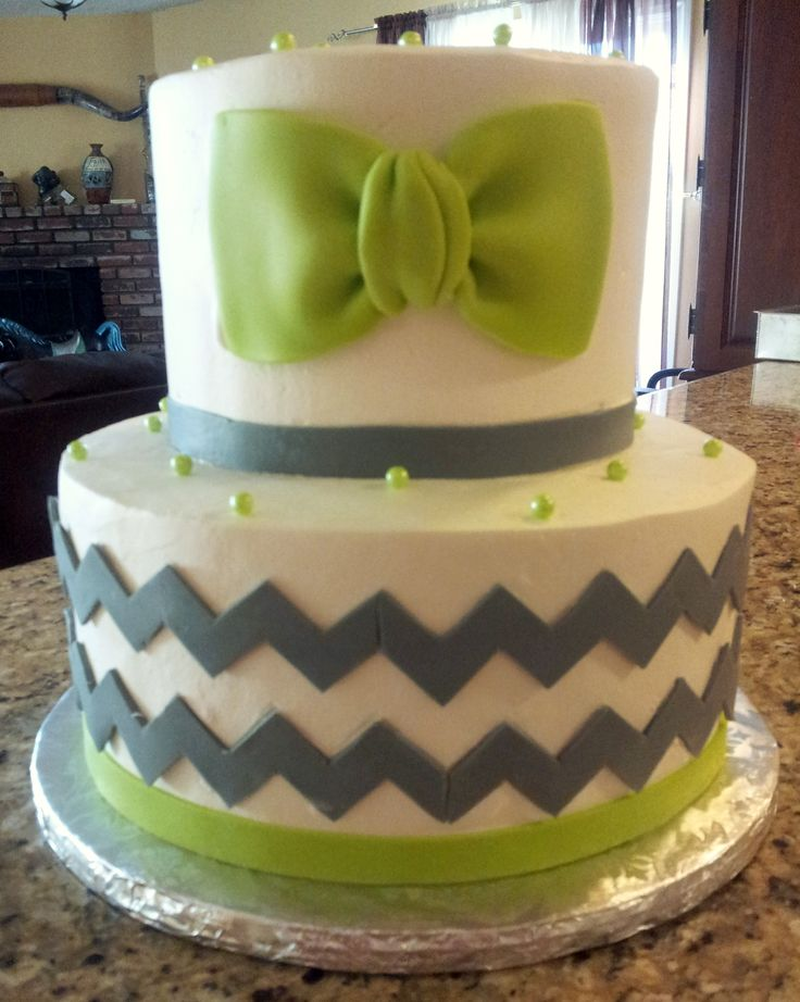 """Bowtie and Chevron Baby Shower cake - 7"""" and 10"""" rounds. All frosted in Pastry Pride. The chevron and bowtie are made of modeling chocolate. The colors were lime green and gray. I wasn't too sure of the combination of colors but in the end, I really liked it!"""