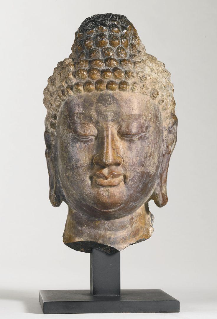 A RARE GRAY LIMESTONE HEAD OF BUDDHA China, Tang dynasty
