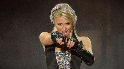 """After Paris Hilton's unreleased """"Last Night"""" single surfaced on Pitbull's album last week, the hotel heiress' original version of the track leaked online Tuesday. Hilton takes the reigns on Afrojack production, which now features rapper Lil Wayne. Listen to the song and read the full story here: http://www.examiner.com/article/paris-hilton-s-shelved-last-night-single-leaks-online-features-lil-wayne"""