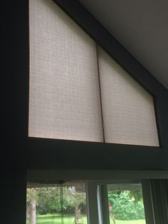 Solution to sun glare from odd shaped window.  Made the frame from trim wood and covered with sunbrella fabric.  Estimate for pleated shade was $650-850.  This was under $70.