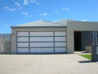 Eden style custom garage door with a double sided feature panel design - Automatic Remote Access