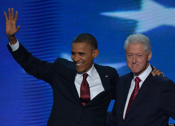 The 42nd President of the United States Bill Clinton & the 44th President of the United States Barack Obama acknowledge tha audience at the Time Warner Cable Arena in Charlotte, North Carolina, on September 5, 2012 on the second day of the Democratic National Convention (DNC).