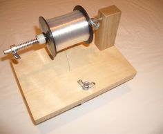 Build an inexpensive device (about $8.00) for filling fishing reels with line. Easy to use, tangle-free, solo-operable, far cheaper, and just as effective as commercial models, which sell for $30 to $120. It will work with all reels and spool configurations. Can be mounted horizontally on a table or workbench or vertically on a door or bookshelf.