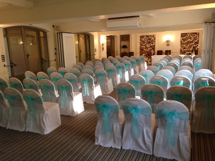 Chair covers with turquoise sashes