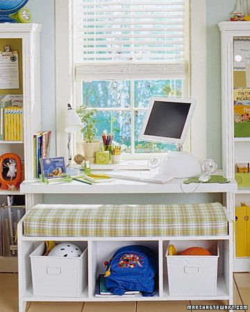 built in desk between shelves and under window with bench for maximum storage.