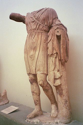 Statue of a military officer from Delphi, Greece wearing a military chiton , this statue was made c. 335 BCE.  FOUND:http://www.djibnet.com/photo/classical+art