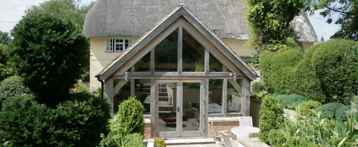 oak frame extension to thatched cottage
