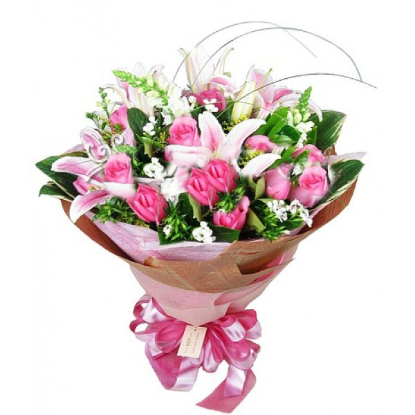 2 pink lilies and 12 peach roses and complement each other to make a bewitching bouquet that will enchant her speechless.wrapped old fashion newspaper and tied with silk ribbon. Buy #Flowers Online for #China