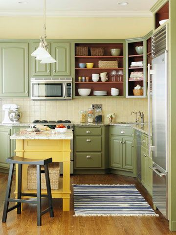 Open to Color- Open shelving adds a sense of spaciousness to this small kitchen. Getting the look can be as easy as removing doors from existing cabinetry. Paint the inside of the cabinets a favorite hue to create a pretty backdrop for dishes, glassware, and storage baskets.