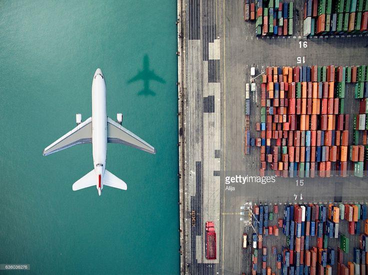 ストックフォト : Airplane flying over container port