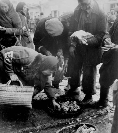 Lublin, Poland, Selling and buying fish in the ghetto.  Belongs to collection: Yad Vashem Photo Archive  Additional Information: The Jews in...