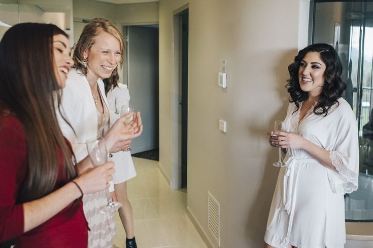 Bride celebrating the morning with her bridesmaid team in her dressing room.