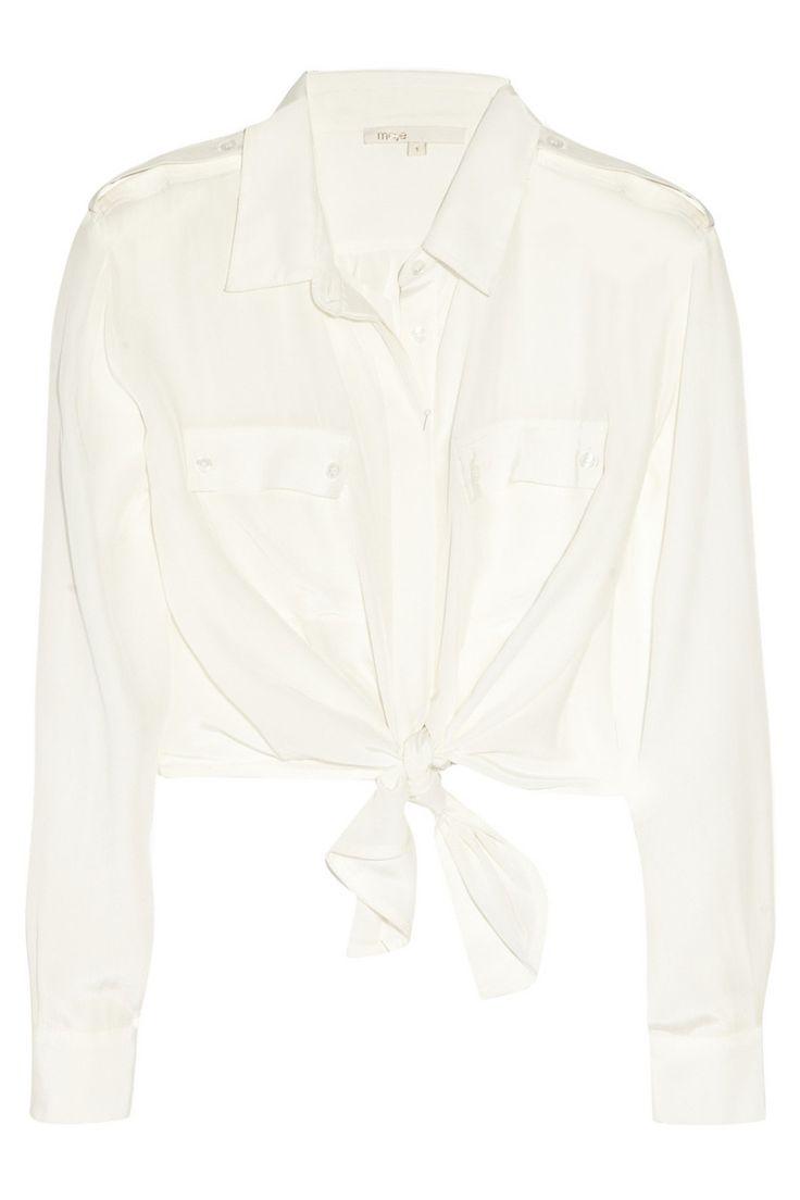 Maje  La camisa blanca  Camisa anudada en la cintura de Maje para Net-a-porter (ver precio). Foto: Cortesía de Net-a-porter Fuente: vogue.es