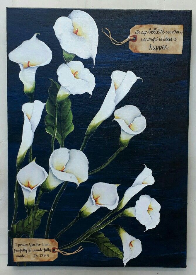 Fussy cut lilies on stretch canvas. Background painted blue and black