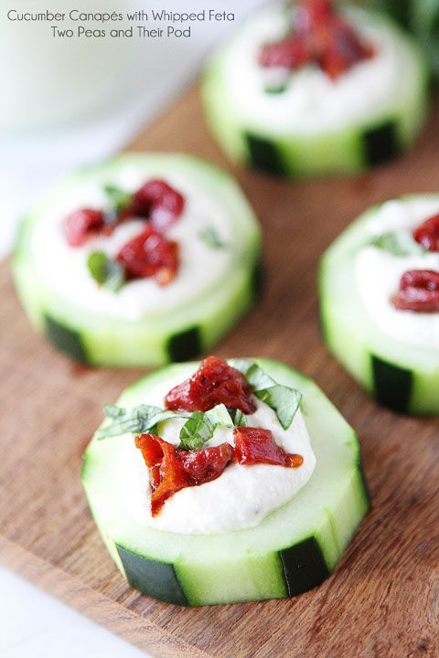 Cucumber Canapés with Whipped Feta, Sun-Dried Tomatoes and Basil on twopeasandtheirpo... An easy appetizer for the holidays!