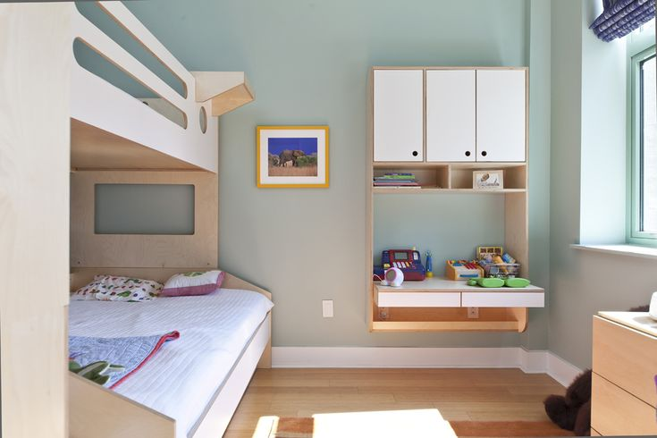 The hanging desk from our Flote Collection is the ideal suspended solution for a space saving work area. We utilized the existing outlets and built these into the suspended piece. We also coordinated its placement so the twin trundle could open easily.  #casakids #kidsroom #custom