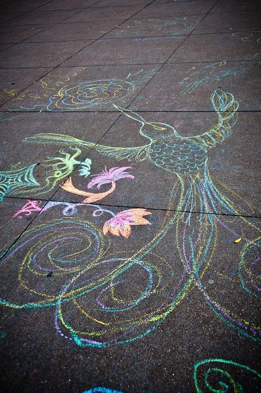 a sidewalk chalk  humming bird