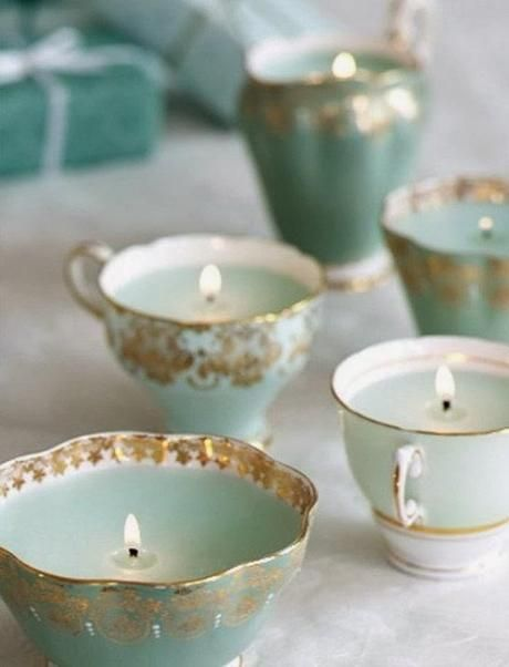 Vintage tea cup candles Love this idea.  I was also thinking of distressed picture frames as part of the table centerpieces