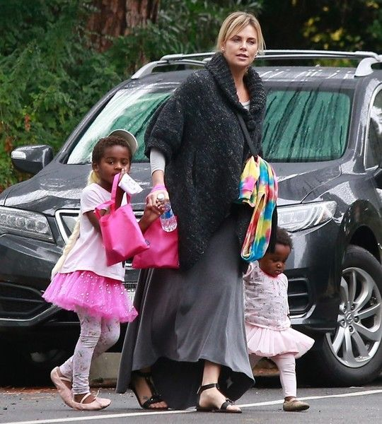 Actress Charlize Theron takes her two kids Jackson Theron and August Theron to a birthday party in Beverly Hills, California on October 30, 2016.