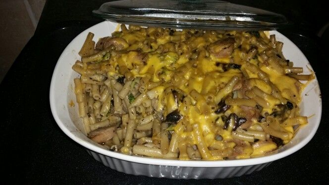 Pasta with sausages, mushrooms, broccoli and baked with cheddar cheese toping