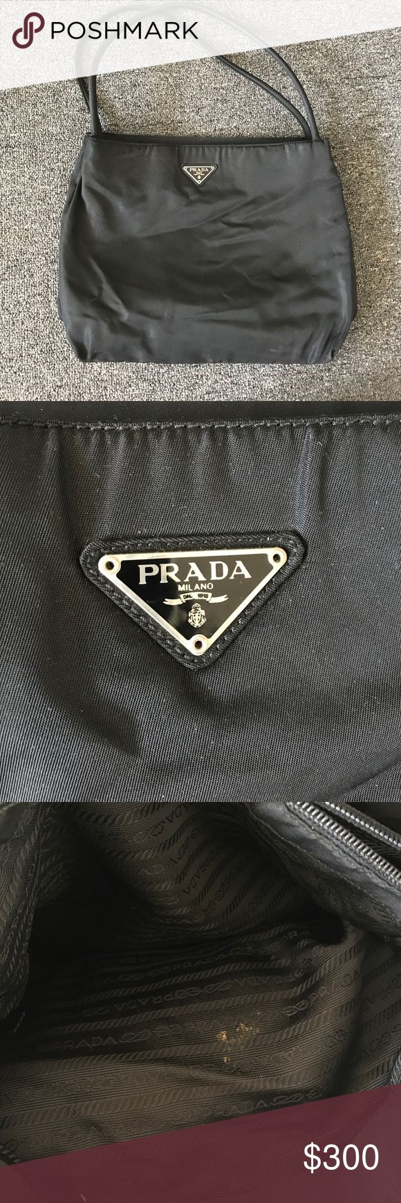 Black fabric Prada tote bag Prada tote bag in black fabric. Some wear. Missing zipper pull on interior pocket, and stain in the interior as well. Small scratch on bottom, otherwise in good condition. 2 interior portions plus zipper portion. Prada Bags Totes