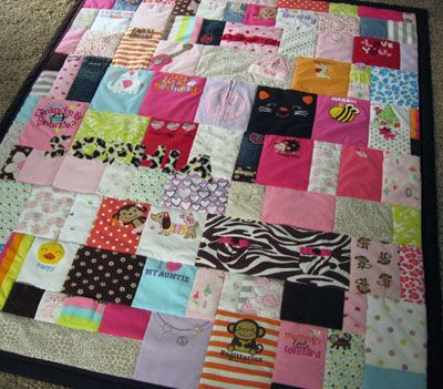 Memory quilt, made out of old baby clothes. LOVE this idea but it would never happen for me :/